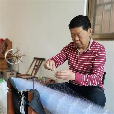 独特的江川渔文化| 手工织渔网