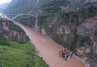 Poverty-stricken villagers say goodbye to terrifying ropeways