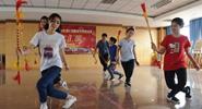 Thirteen Thai students play folk instruments in Yunnan